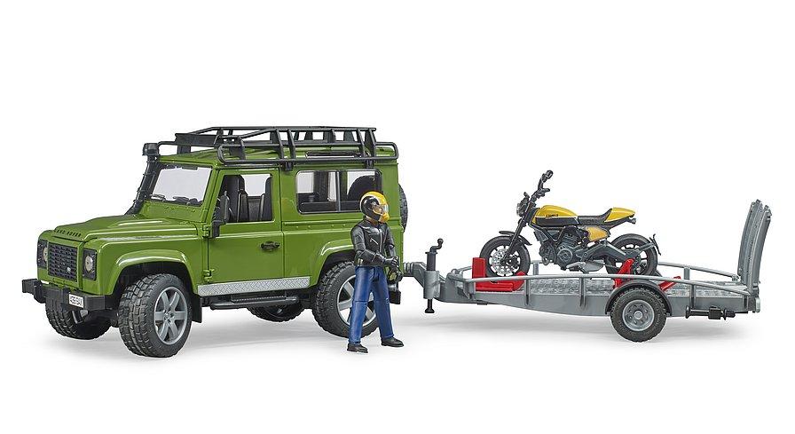 Land Rover terreinwagen met motor op aanhanger (02589)